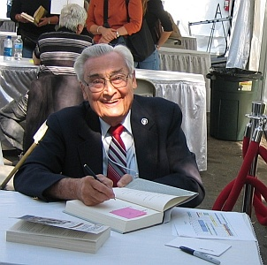 Robert M. Utley at a book signing